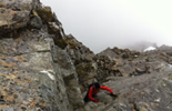 Climbing the 40ft corner on N E Buttress